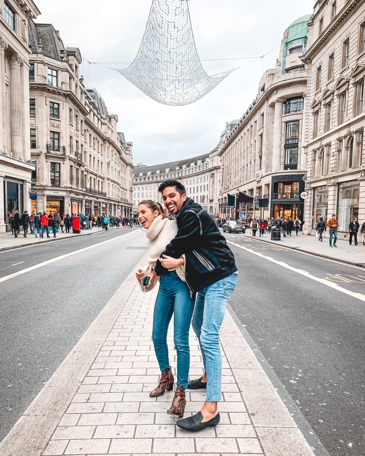 The 2019 Edit: Progress - Aftab and Alice laughing in Regent's Street, London.