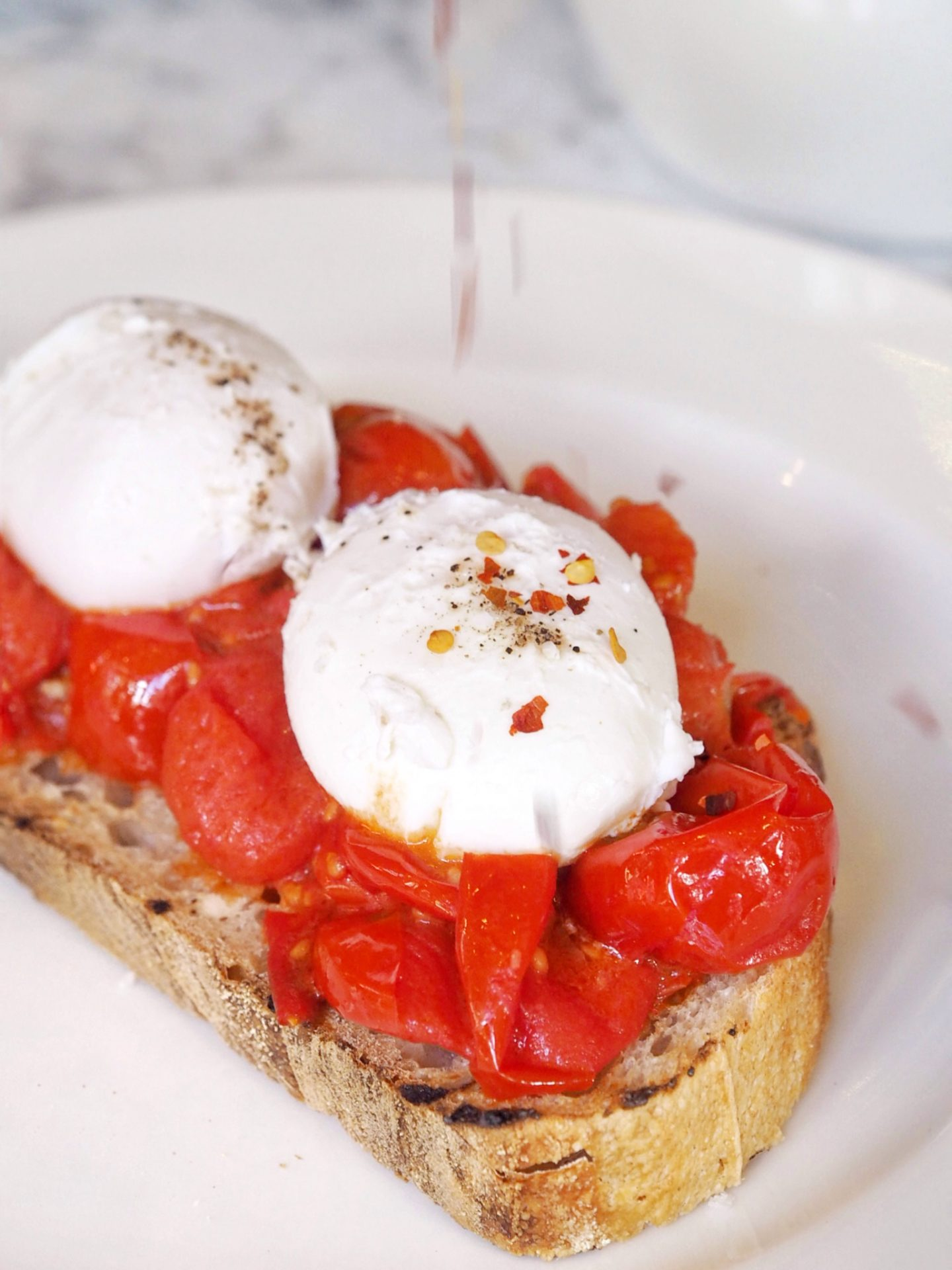 Sourdough bread, grilled tomatoes and poached eggs