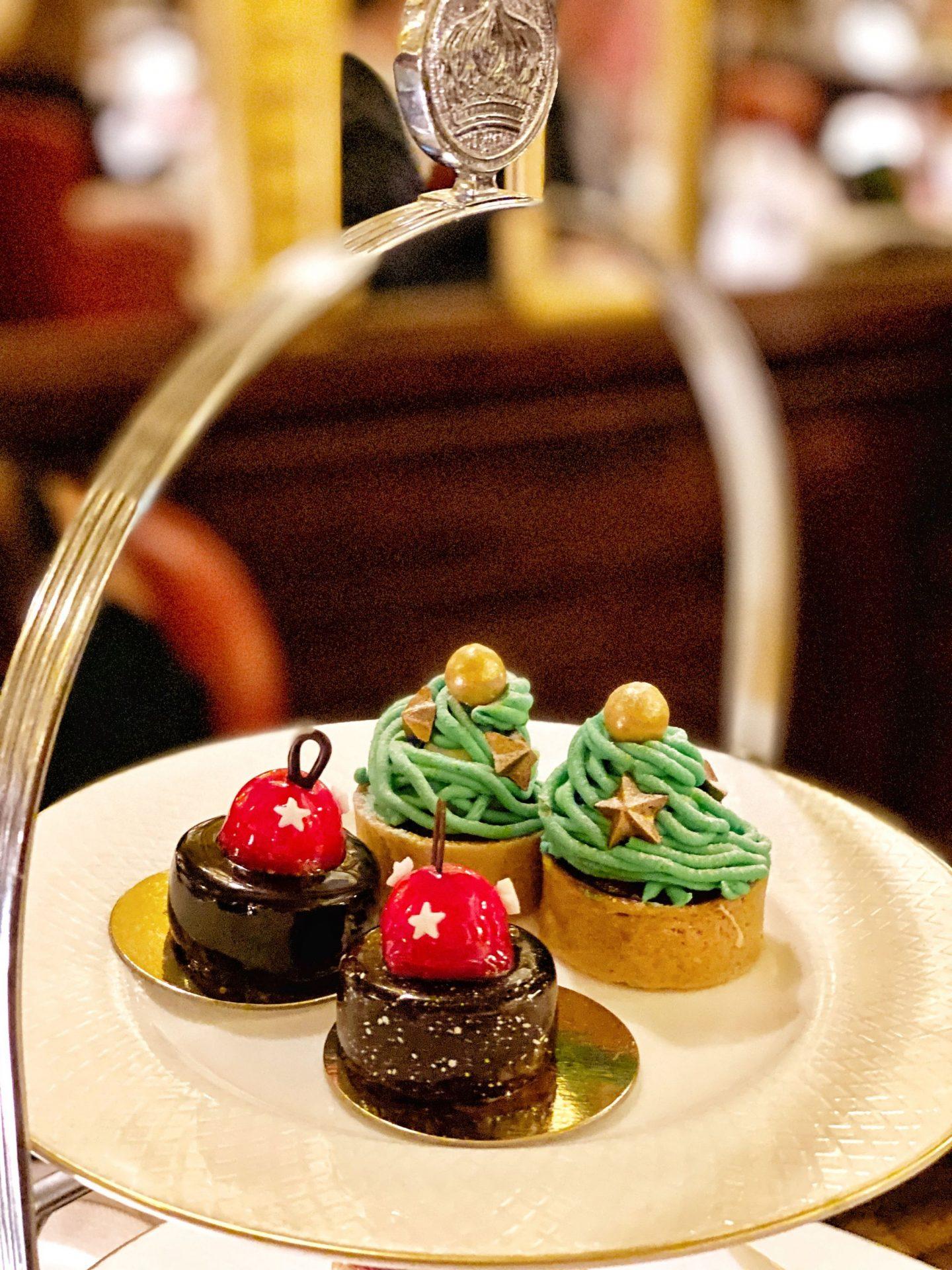 Chocolate and cherry cake and Christmas pudding tart with cinnamon ganache